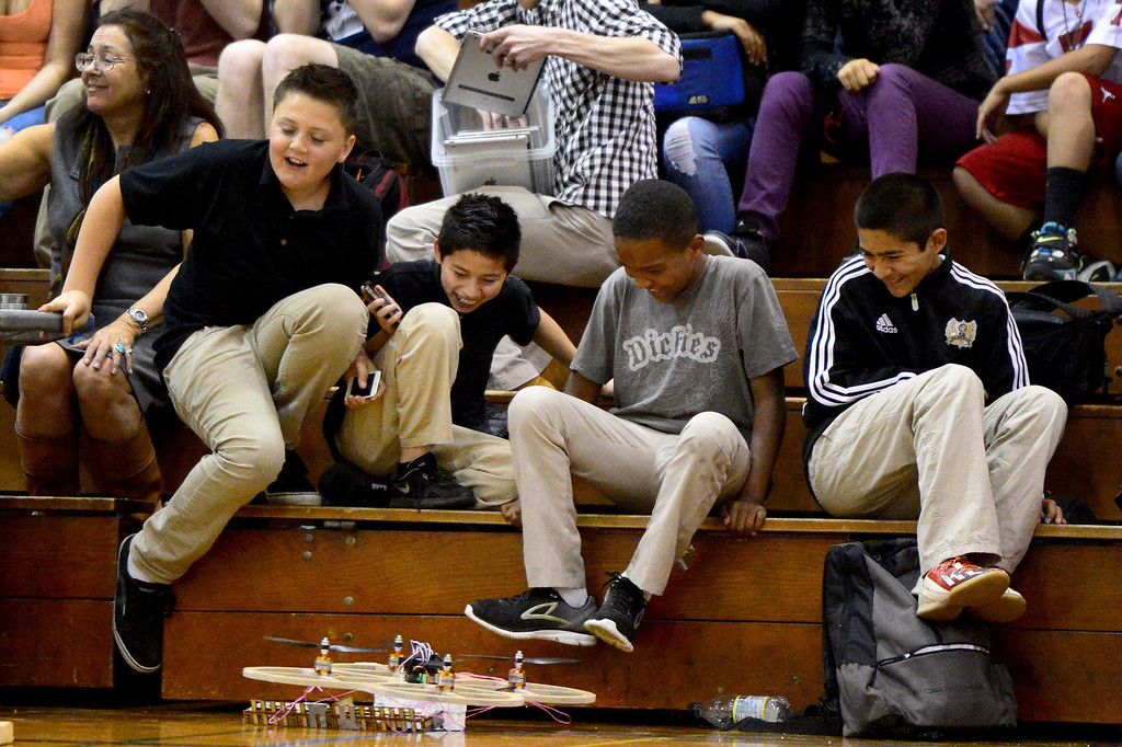 Description of . Children avoid competing robots as teams of mechanical engineering Caltech students compete in the annual ME72 Engineering Design Contest at the Pasadena campus Tuesday, March 11, 2014. The goal in