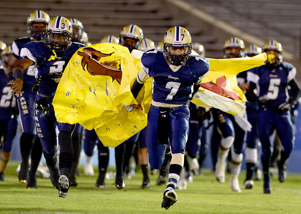 Description of . Muir enters the field during the annual Turkey Tussle against Pasadena Friday night, November 8, 2013 at the Rose Bowl in Pasadena. (Photo by Sarah Reingewirtz/Pasadena Star-News)