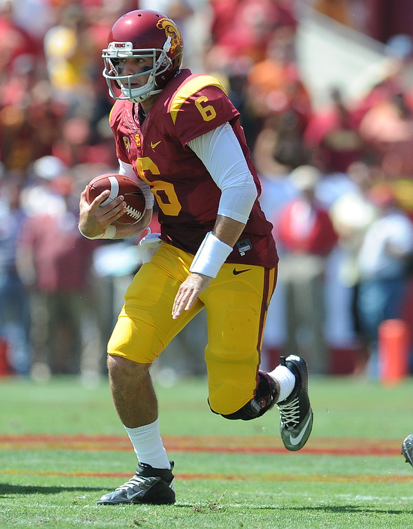 Description of . Southern California quarterback Cody Kessler (6) scrambles before passing for a touchdown against Boston College during the first half of an NCAA college football game in the Los Angeles Memorial Coliseum in Los Angeles, on Saturday, Sept. 14, 2013.