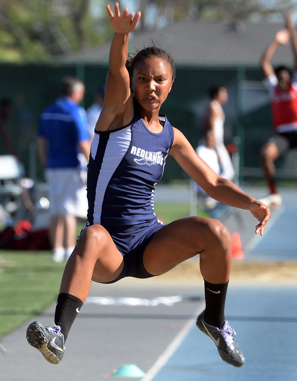 Description of . Redlands' Margaux Jones competes in the long jump during the CIF-SS Masters Track and Field meet at Falcon Field on the campus of Cerritos College in Norwalk, Calif., on Friday, May 30, 2014.   (Keith Birmingham/Pasadena Star-News)