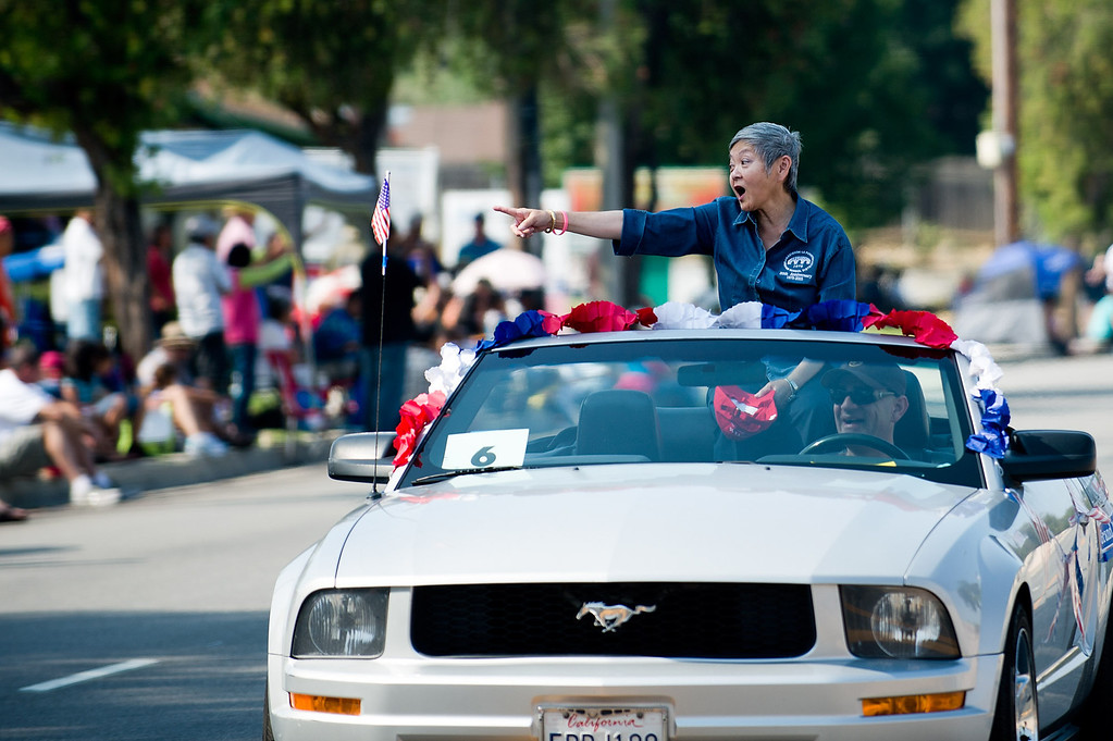 Description of . I Love America parade grand marshal Barbara Nakaoka rides down Stimson Avenue in Hacienda Heights on Thursday, July 4, 2013. (SGVN/Staff photo by Watchara Phomicinda)