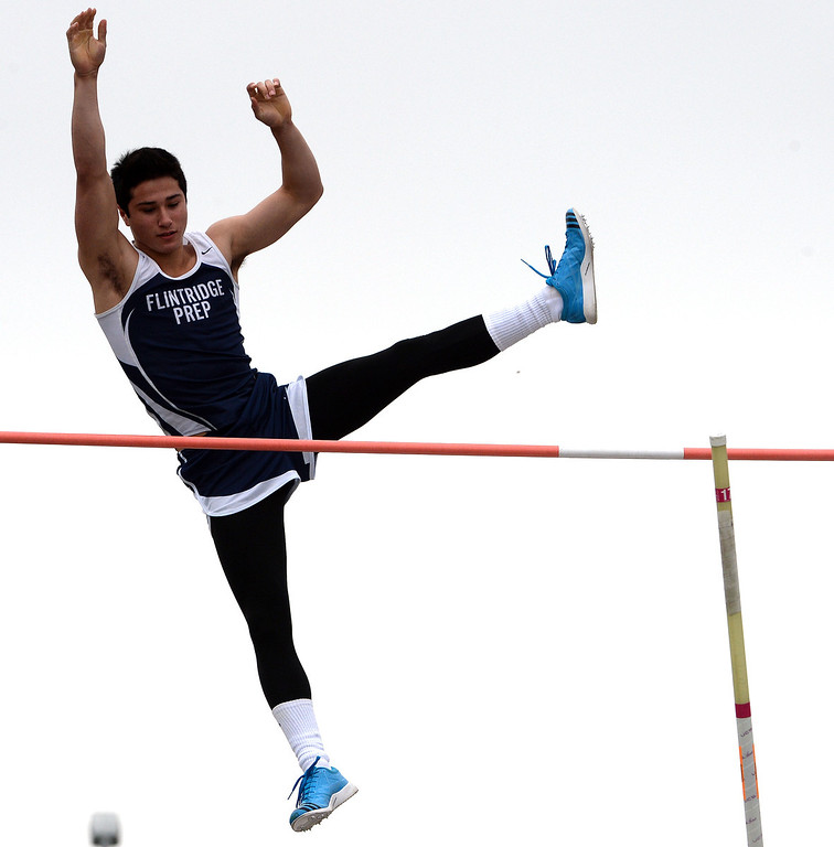 Description of . Flintridge Prep's Gareth Weiss competes in the pole vault during the CIF Southern Section track and final Championships at Cerritos College in Norwalk, Calif., on Saturday, May 24, 2014. 