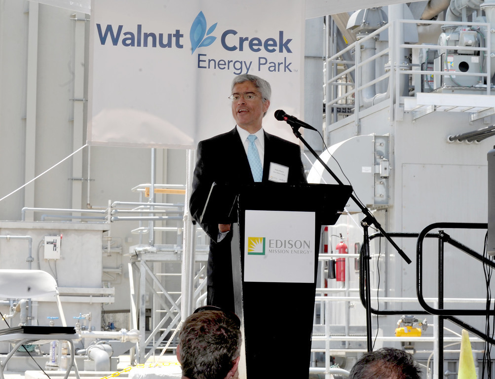 Description of . Edison Mission Energy President Pedro Pizarro speaks as they dedicate the new Walnut Creek Energy Park in the City of Industry on Friday May 9, 2013. The 479 mega-watt project can produce enough energy to power 165,000 home air conditioning systems in the Los Angeles area. (SGVN/Staff Photo by Keith Durflinger)