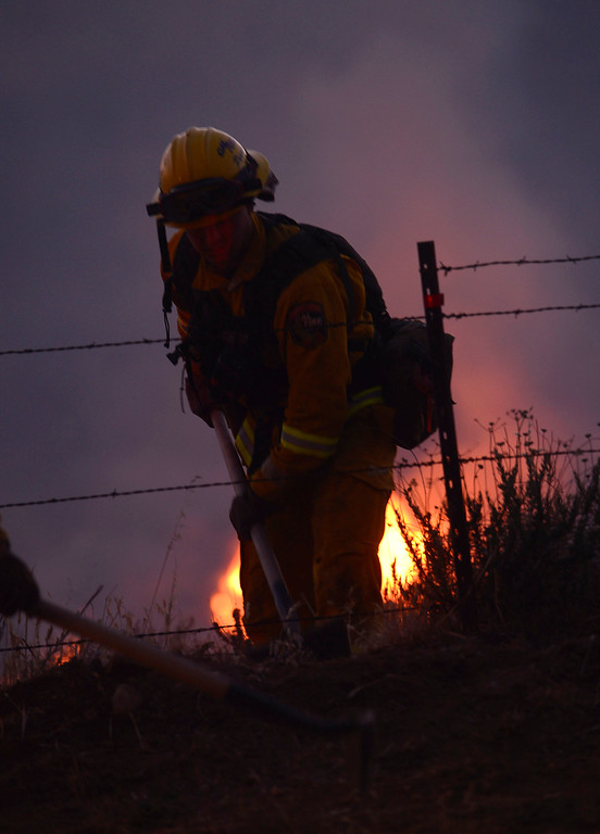 Description of . Fire crews work the Summit Fire along Sunset Avenue in Banning May 1, 2013.  The fire has burned over 1700 acres and is only 30% contained.  CAL Fire, San Bernardino County, and Riverside County, and Riverside City Fire Departments have responded to the blaze which caused evacuations.  GABRIEL LUIS ACOSTA/STAFF PHOTOGRAPHER.
