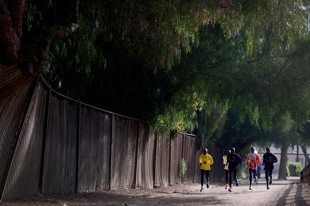 Description of . Elite marathon runners train for Sunday's LA Marathon before visiting with students, of the Students Run LA program, at Griffith Park in Los Angeles Friday, March 7, 2014. (Photo by Sarah Reingewirtz/Pasadena Star-News)