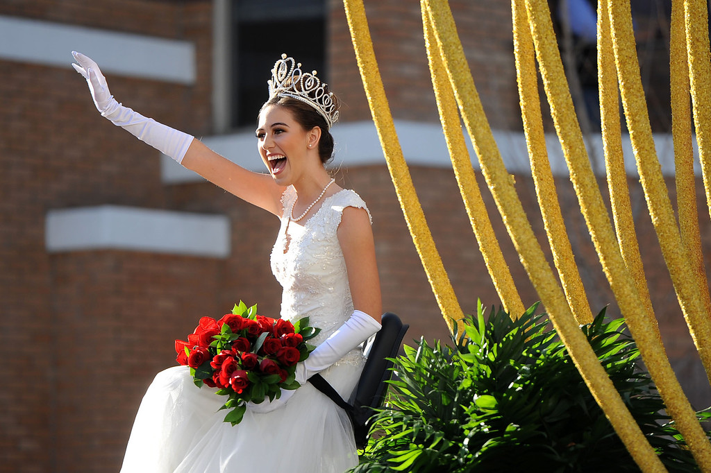Description of . Rose Queen Ana Marie Acosta waves to the crowd during the 2014 Rose Parade in Pasadena, CA January 1, 2014.(Andy Holzman/Los Angeles Daily News)