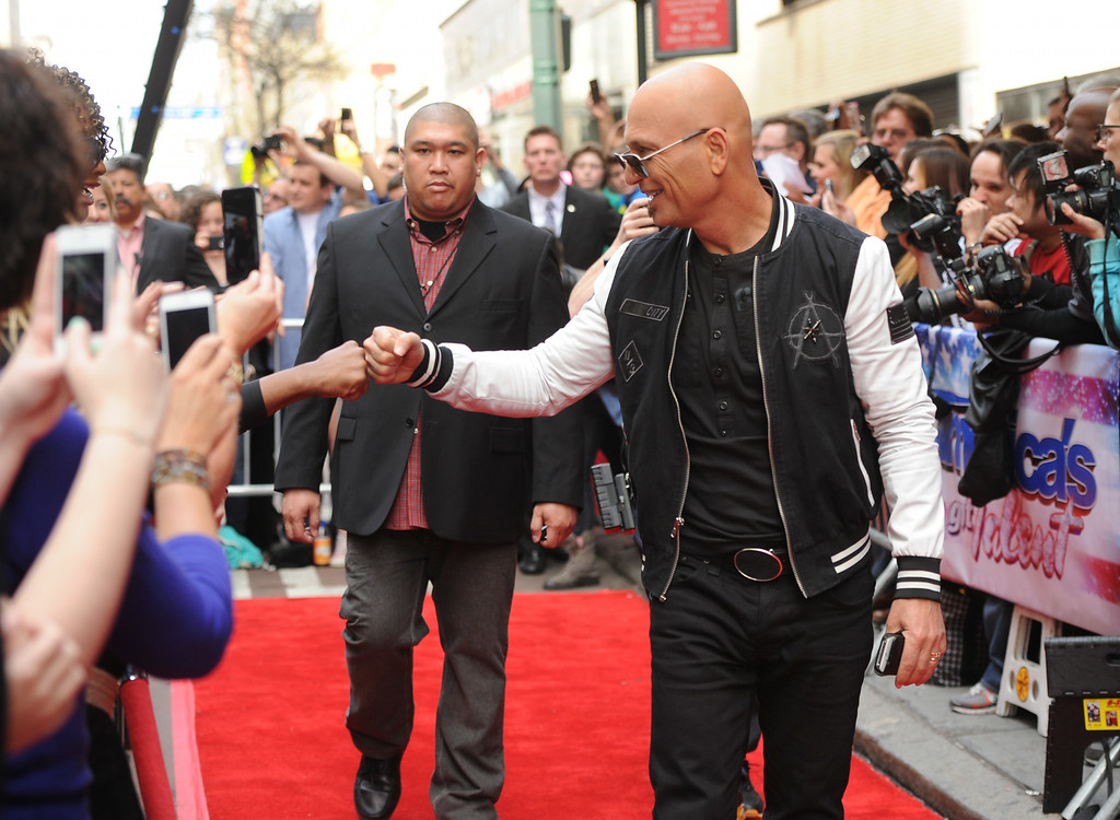 "Description of . Celebrity judge Howie Mandel arrives at the ""America\'s Got Talent\"" auditions on Tuesday April 9, 2013 in New York. (Photo by Evan Agostini/Invision/AP)"