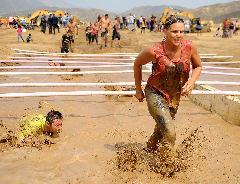 Description of . The 9th Annual SBSD Mud Run was held on Saturday May 18, 2013 at the San Bernardino County Sheriff's Department Training Center in Devore. The 2013 SBSD Mud Run involves several obstacles, low-crawls, mud-pits, and hills. All proceeds raised during the event going to local charities throughout the Inland Empire.LaFonzo Carter/ Staff Photographer