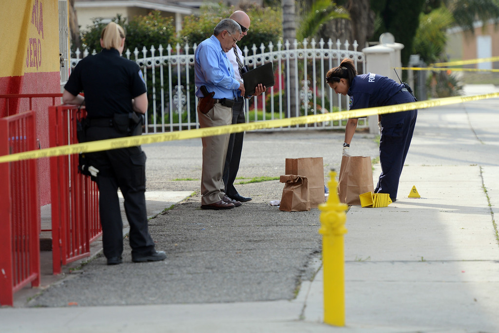 Description of . San Bernardino Police officials investigate the scene of a shooting at Medical Center Drive and Union Street in San Bernardino, CA, Wednesday, March 5, 2014. (Photo by Jennifer Cappuccio Maher/Inland Valley Daily Bulletin)