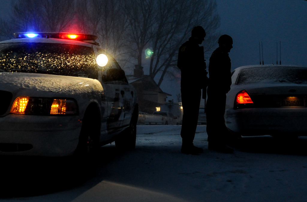 Description of . Heavy snow begins to fall as authorities continue their manhunt for ex-LAPD fugitive Christopher Jordan Dorner in Big Bear on Friday, Feb. 8, 2013.(Staff photo by Rachel Luna/The Sun)