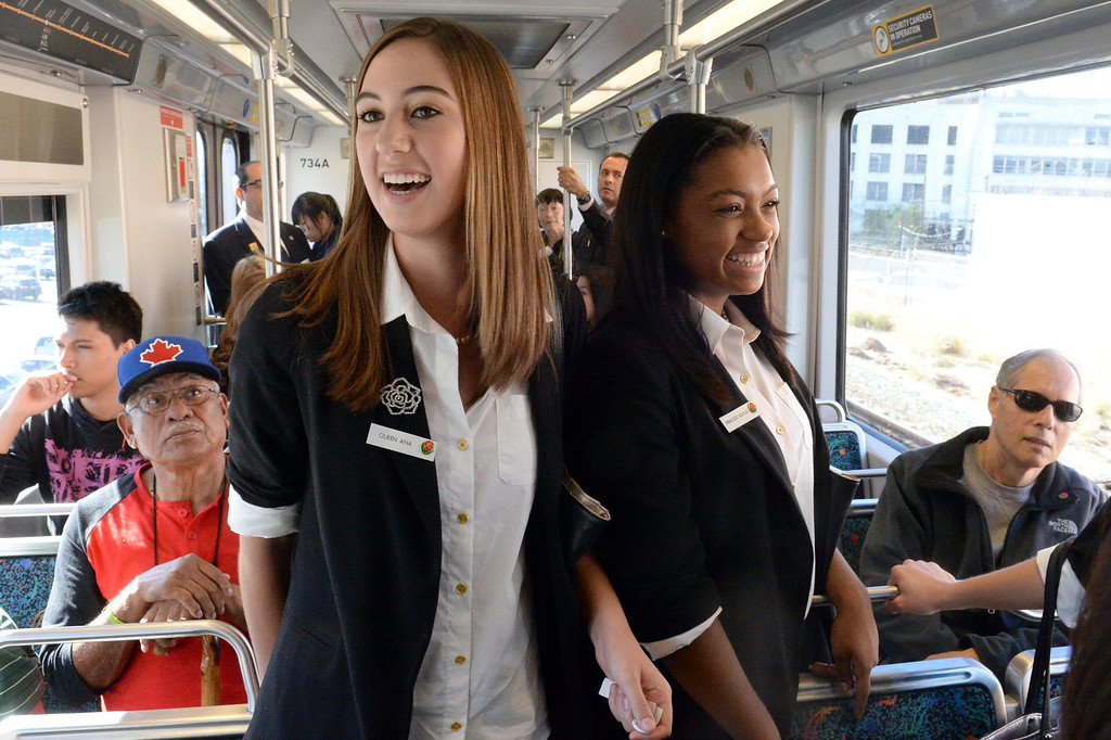 Description of . The 2014 Tournament of Roses Queen Ana Acosta, left, and Princess Kayla Johnson-Granberry join officials from the Los Angeles County Metropolitan Transportation Authority (Metro) as they ride the g\Gold Line from historic Union Station on Friday December 27, 2013. The event is to commemorate the 10th official year of Metro Rail service to the Tournament of Roses parade events at Union Station. (Staff Photo by Keith Durflinger/Pasadena Star-News)