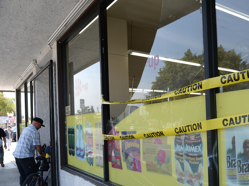Description of . A broken window at the Jumbo Dollar store in La Habra has caution tape put across it after the 5.1 earthquake centered in La Habra on Saturday March 29, 2014. (Staff Photo by Keith Durflinger/Whittier Daily News)