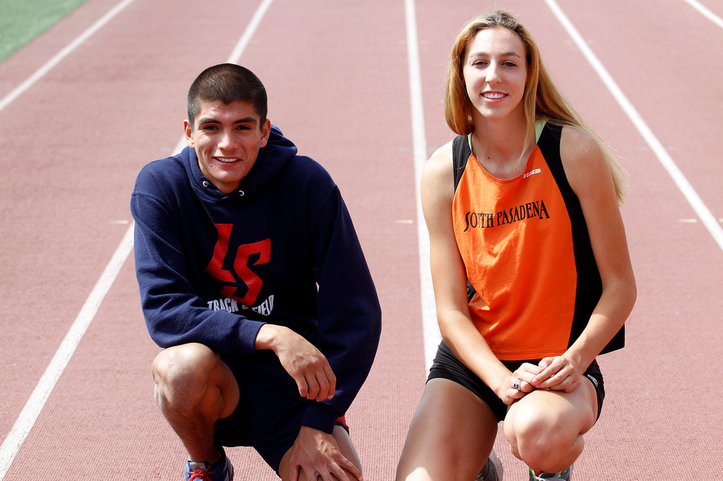 Description of . Star-News Track and Field Athletes of the Year, Daniel De La Torre, from La Salle High School, and Claire Kieffer-Wright, of South Pasadena High School, pose for a picture, at the South Pasadena High School track, in South Pasadena, Friday, June 14, 2013. (Correspondent Photo by James Carbone/SXSPORTS)