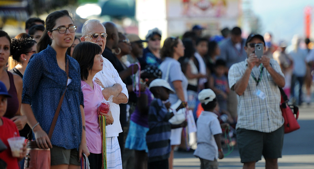 Description of . Fair goers watch the Diamond Bar community parade during the 91st Annual L.A. County Fair in Pomona, Calif. on Thursday, Sept. 5, 2013.   (Photo by Keith Birmingham/Pasadena Star-News)
