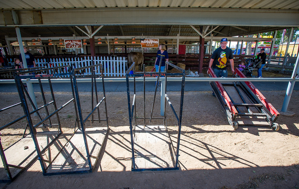 Description of . Preparations are made for opening day of the San Bernardino County Fair in Victorville, Friday,  May 24 2013. (Eric Reed/The Sun)