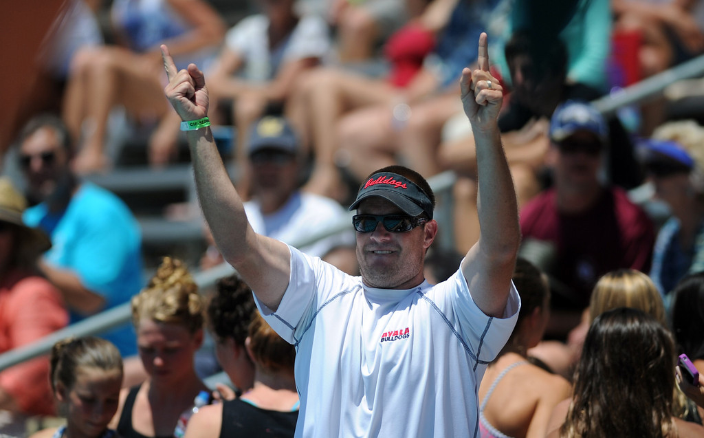 Description of . Ayayla coach reacts after they won the girls 100 yard breaststroke during the CIF-SS Division II swim finals at Riverside City College on Saturday, May 11, 2013 in Riverside, Calif.  (Keith Birmingham Pasadena Star-News)