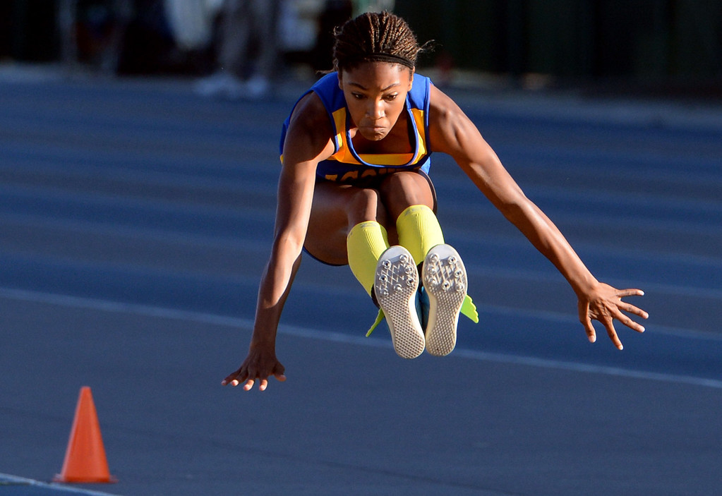 Description of . Agoura's Tara Davis competes in the Triple Jump during the CIF-SS Masters Track and Field meet at Falcon Field on the campus of Cerritos College in Norwalk, Calif., on Friday, May 30, 2014.   (Keith Birmingham/Pasadena Star-News)