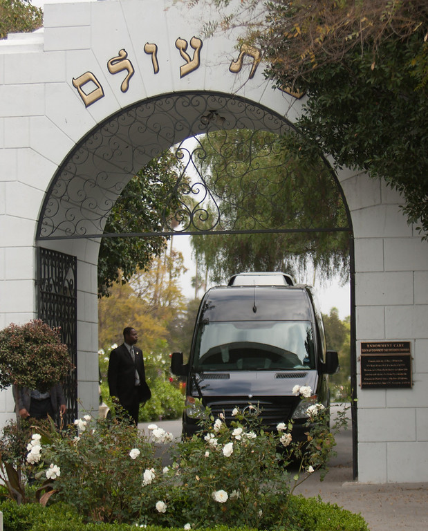 Description of . A small bus with guests of Mick Jagger and close family members of his late girlfriend LWren Scott  departs Hollywood Forever Cemetery in Hollywood,California on March 25,2014. LWren Scott killed herself in New York last week. The service was held at the famed Hollywood Forever Cemetery in Los Angeles, which was closed for the roughly one-hour service, held amid tight security.           (JORGE CRUZ/AFP/Getty Images)