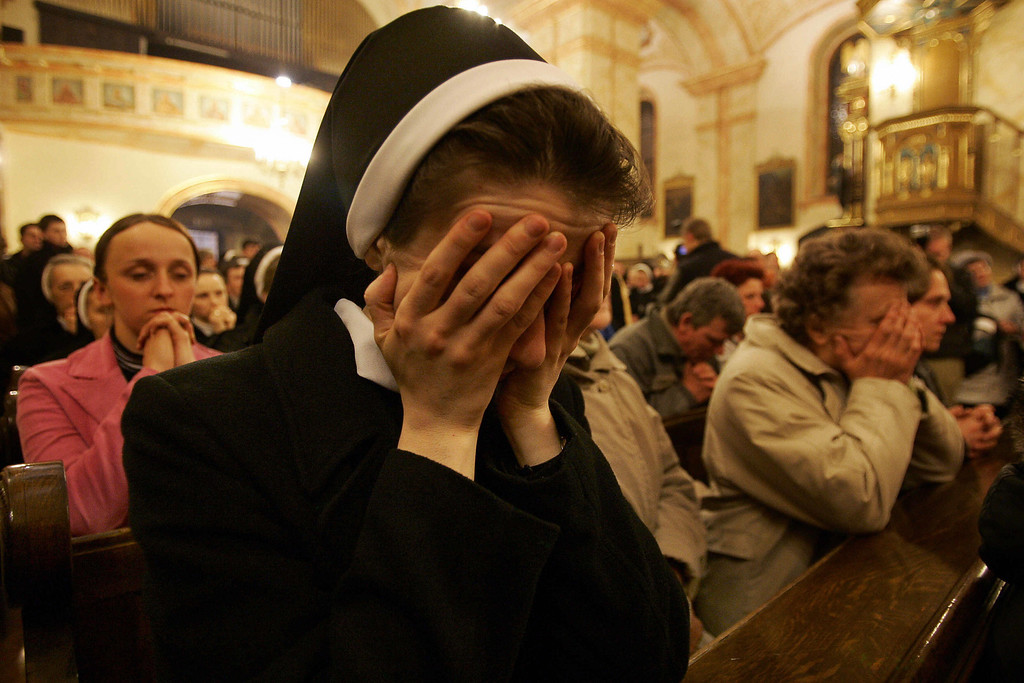 Description of . A nun and other Catholics pray during an evening mass in  the church in Wadowice, the home town of Pope John Paul II  01 April 2005 . Pope John Paul II  received last rites following a heart attack as senior cardinals prepared Catholics around the world for his demise.   (JANEK SKARZYNSKI/AFP/Getty Images)