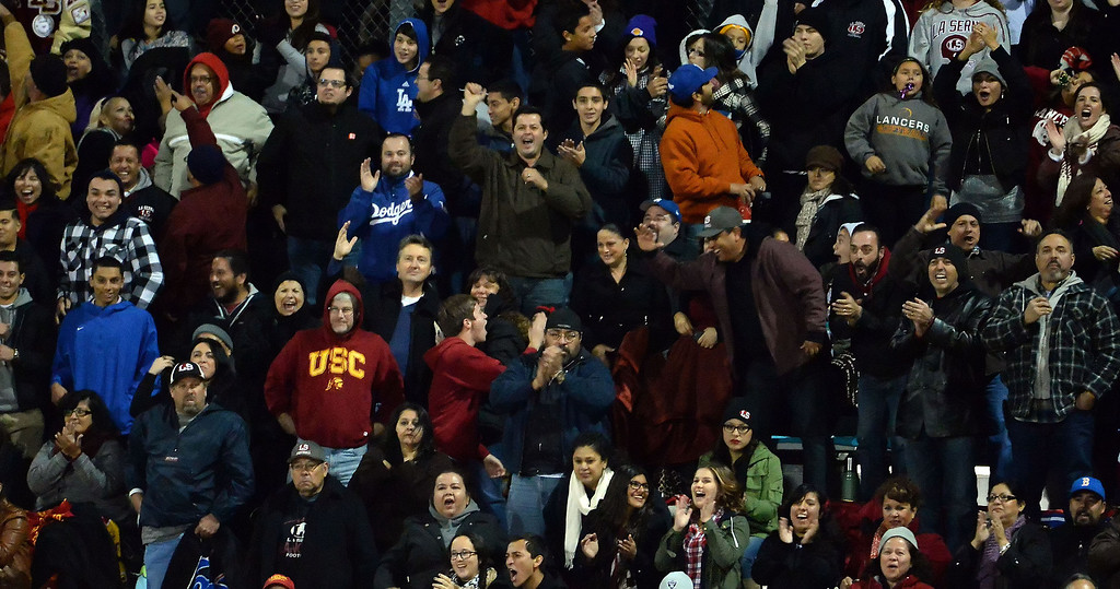 Description of . La Serna fans react after Bryce Oliver (not pictured) runs for a touchdown against Diamond Bar in the first half of a CIF-SS playoff football game at Diamond Bar High School in Diamond Bar, Calif., on Friday, Nov. 22, 2013.   (Keith Birmingham Pasadena Star-News)