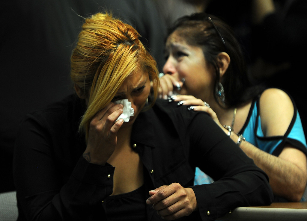 Description of . Janet Cruz,left and Rosie Curonilla, mother of Daniel Olivera breaks down after watching a surveillance footage of her son death during a press conference at the San Bernardino County Sheriff's Head quarters Thursday August 22, 2013 in San Bernardino. Daniel Olivera 26, of Hesperia was shot and killed at the AM/PM Arco convenience store on August 11, 2013 in Victorville.LaFonzo Carter/Staff Photographer