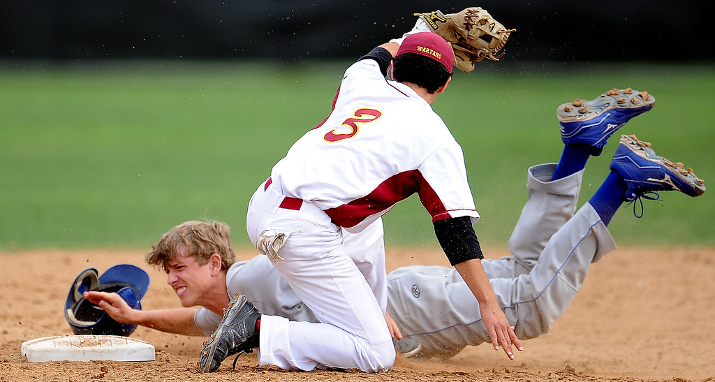 Description of . San Marino's Willie Forgatch is tagged out by La Canada shortstop Clayton Herrmann (C) (3) at second base on a attempted steal in the fifth inning of a prep baseball game at La Canada High School on Wednesday, March 8, 2013 in La Canada, Calif. La Canada won 3-2.  (Keith Birmingham Pasadena Star-News)