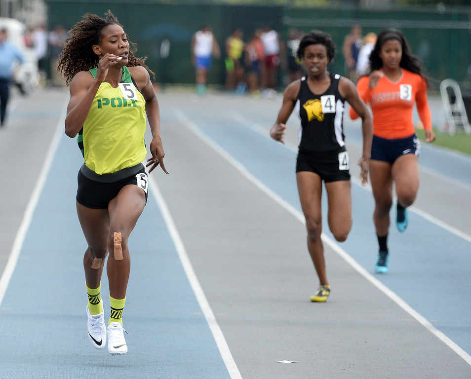 Description of . Long Beach Poly's Kaelin Roberts win the division 1 400 meters race during the CIF Southern Section track and final Championships at Cerritos College in Norwalk, Calif., Saturday, May 24, 2014. 