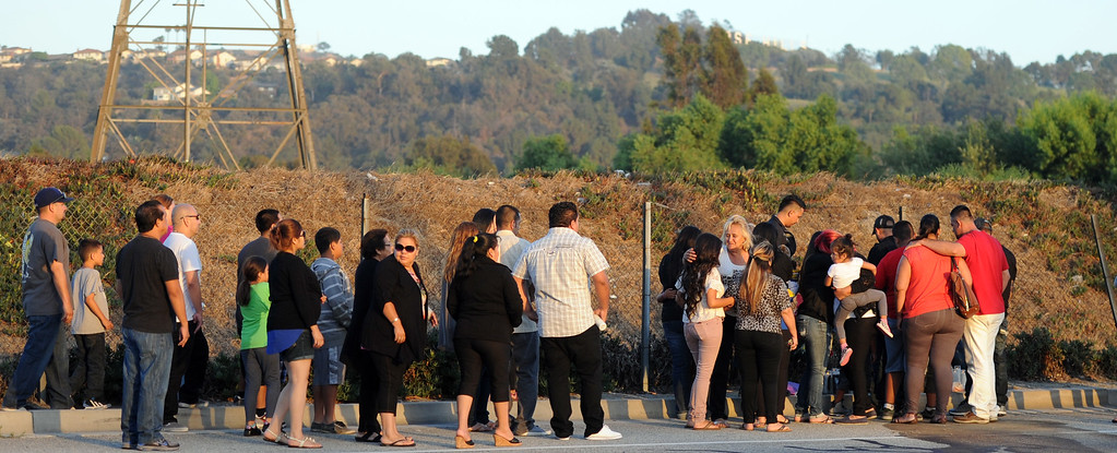Description of . Over 40 family and friends stand in front of a make shift memorial during a vigil for those who died in a car crash including  two children and a man along the 3500 block of San Gabriel River Road on Friday, June 14, 2013 in Industry, Calif.  (Keith Birmingham/Pasadena Star-News)