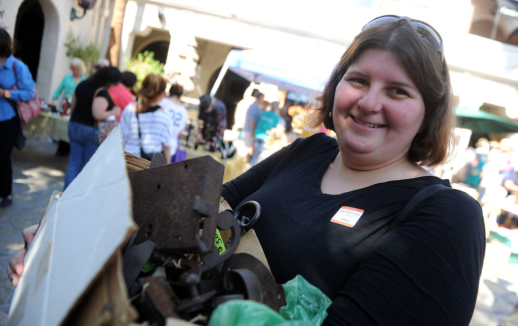 Description of . Libby Cline smiles as she shows off her antique locks she purchased in front of the Pasadena Playhouse during the 8th Annual Pasadena ARTWalk along El Molino Avenue between Colorado Boulevard and Green Street in Pasadena, Calif., on Saturday, Oct. 12, 2013. The ArtWalk features over 30 participating artists, art sales, gallery walks, musical performances and other activities.   (Keith Birmingham Pasadena Star-News)