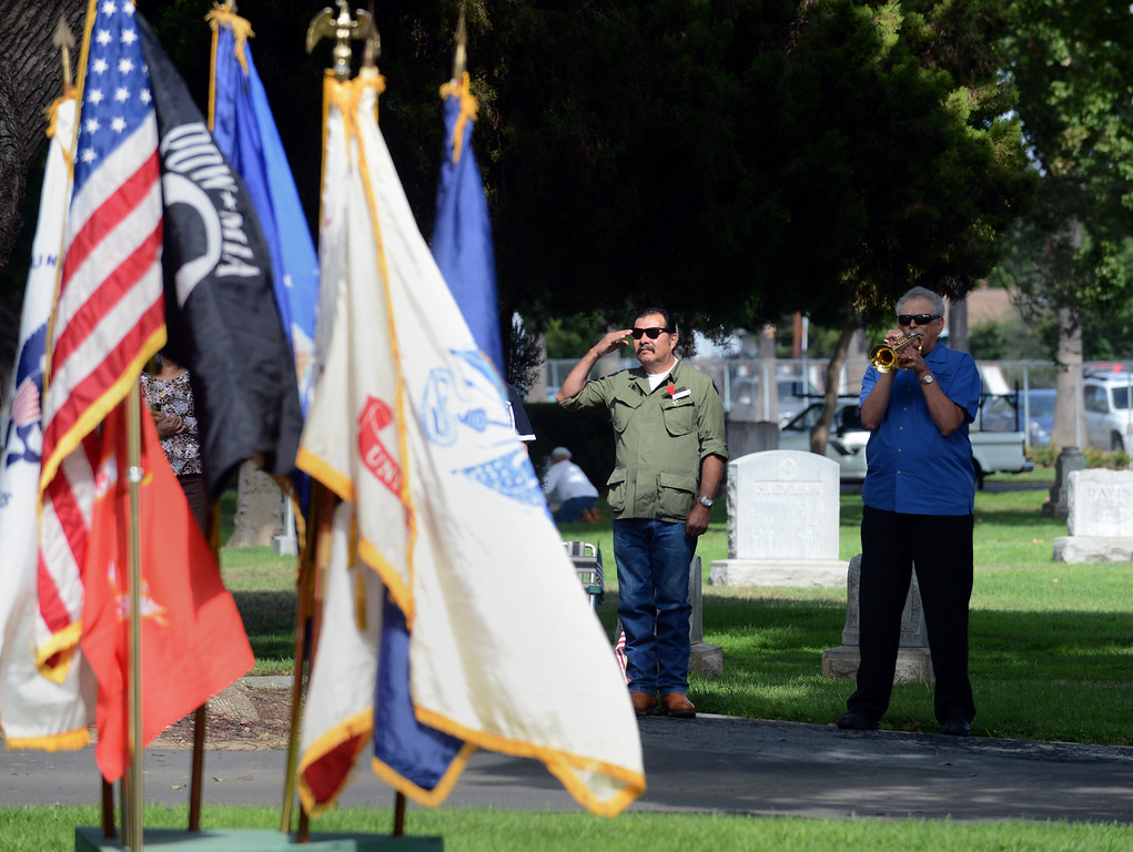 Description of . Memorial Day services Monday, May 27, 2013, at Pomona Valley Memorial Park in Pomona. Jennifer Cappuccio Maher/Staff Photographer