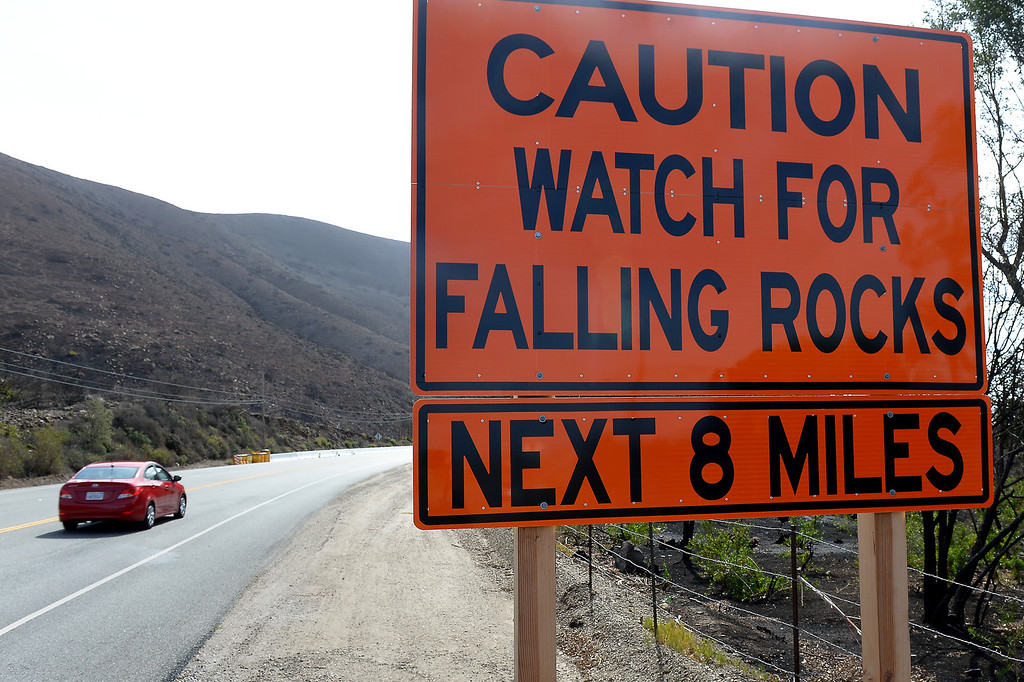 Description of . A sign on Pacific Coast Highway near Pt. Mugu warns of falling rocks along the burnt hillsides from last year's Springs Fire, Thursday, February 27, 2014. (Photo by Michael Owen Baker/L.A. Daily News)