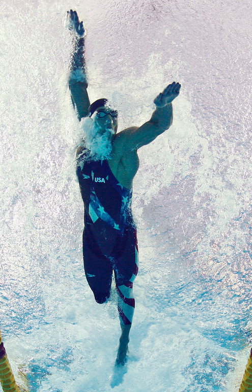 Description of . United States' Michael Phelps swims in the final of the men's 4x100-meter freestyle relay as his team wins the gold during the swimming competitions in the National Aquatics Center at the Beijing 2008 Olympics in Beijing, Monday, Aug. 11, 2008.  (AP Photo/Mark J. Terrill)