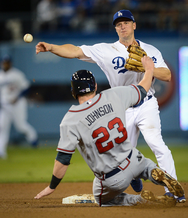 Description of . Dodgers Mark Ellis throws for a DP as Atlanta's Chris Johnson is out at second during game 4 action Monday, October 7, 2013 ( Photo by Hans Gutknecht/Los Angeles Daily News )