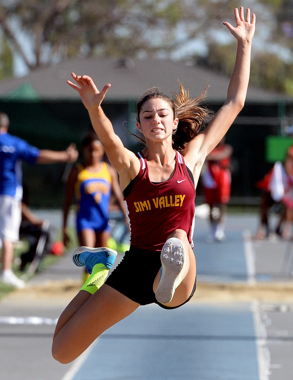 Description of . Simi Valley's Madisen Richards competes in the long jump during the CIF-SS Masters Track and Field meet at Falcon Field on the campus of Cerritos College in Norwalk, Calif., on Friday, May 30, 2014.   (Keith Birmingham/Pasadena Star-News)