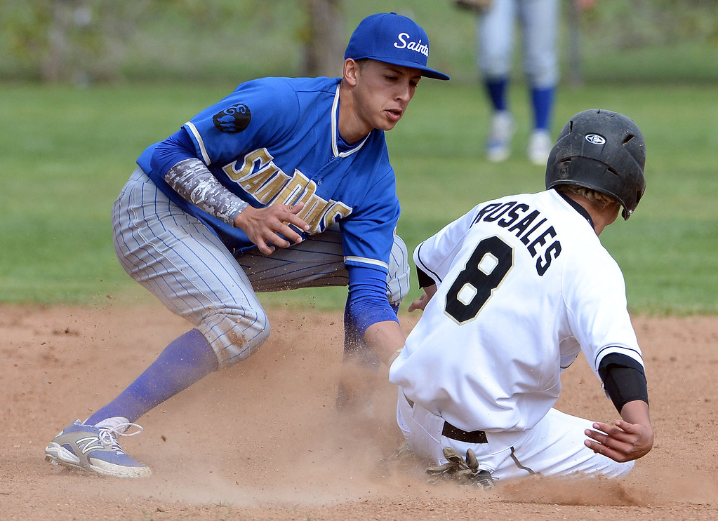 Description of . San Dimas shortstop Josh Avila (C) tags out Northview's Ruben Rosales (8) on a attempted steal of second base in the second inning of a prep baseball game at Northview High School in Covina, Calif., on Wednesday, March 26, 2014. San Dimas won 2-0.
