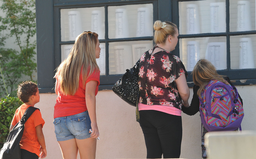 Description of . (John Valenzuela/Staff Photographer) Mckinley Elementary students and parents check the classroom list, before the start of school, Weddnesday in Redlands, August 14, 2014.