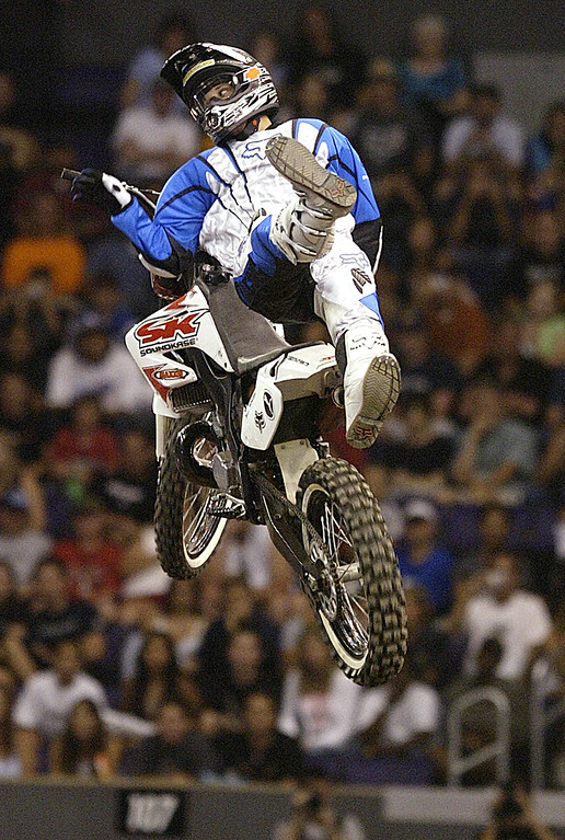 Description of . The 10th X Games at the Staples Center in Los Angeles Thursday August 5,2004. Chuck Carothers of Kingwood, Teaxas win the gold with a score of 93:20 in the Moto X Best Trick.(Pasadena Star-News Staff Photo Keith Birmingham/SXSports)