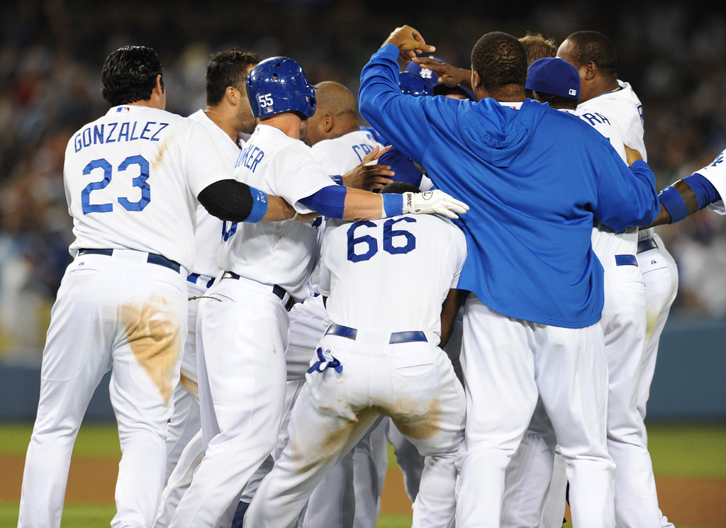 Description of . Dodgers and Andre Ethier celebrate after being driven in by Mark Ellis in the 9th inning for a walk off RBI to end the game. The Dodgers defeated  the NY Yankees 3-2 in a game at Dodger Stadium in Los Angeles, CA. 7/30/2013(John McCoy/LA Daily News)