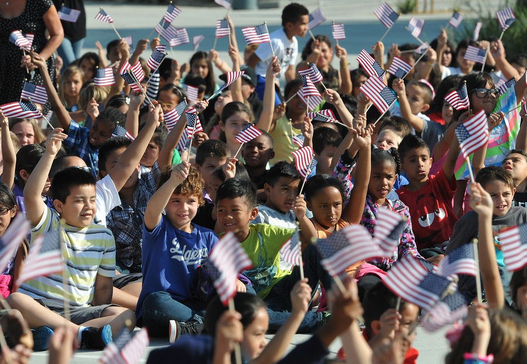Description of . (John Valenzuela/Staff Photographer) Students from Mission Elementary School in Redlands, wave American Flags during the schools Patriot's Day celebration, marking the 12th Anniversary of the 9/11 attacks, Wednesday, September 11, 2013. Military veteran Robert Kafader discussed the tragic events that happen on Sept. 11, 2001, when nearly 3000 people were killed during the terrorist attacks 12 years ago.