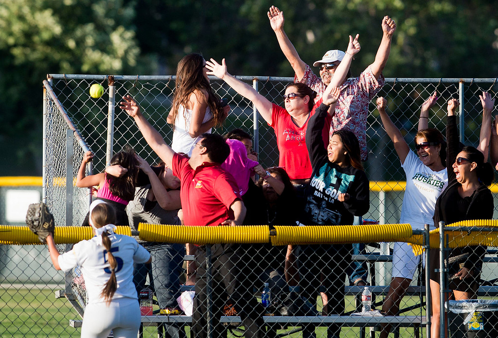 Description of . Fans cheers after South Hills' Natalie Moran hits a home run over the fence during San Gabriel Valley all-star softball game at Diamond Bar High School on Monday, June 3, 2013. South team won 10-5. (Staff photo by Watchara Phomicinda/ Los Angeles Media News Group)