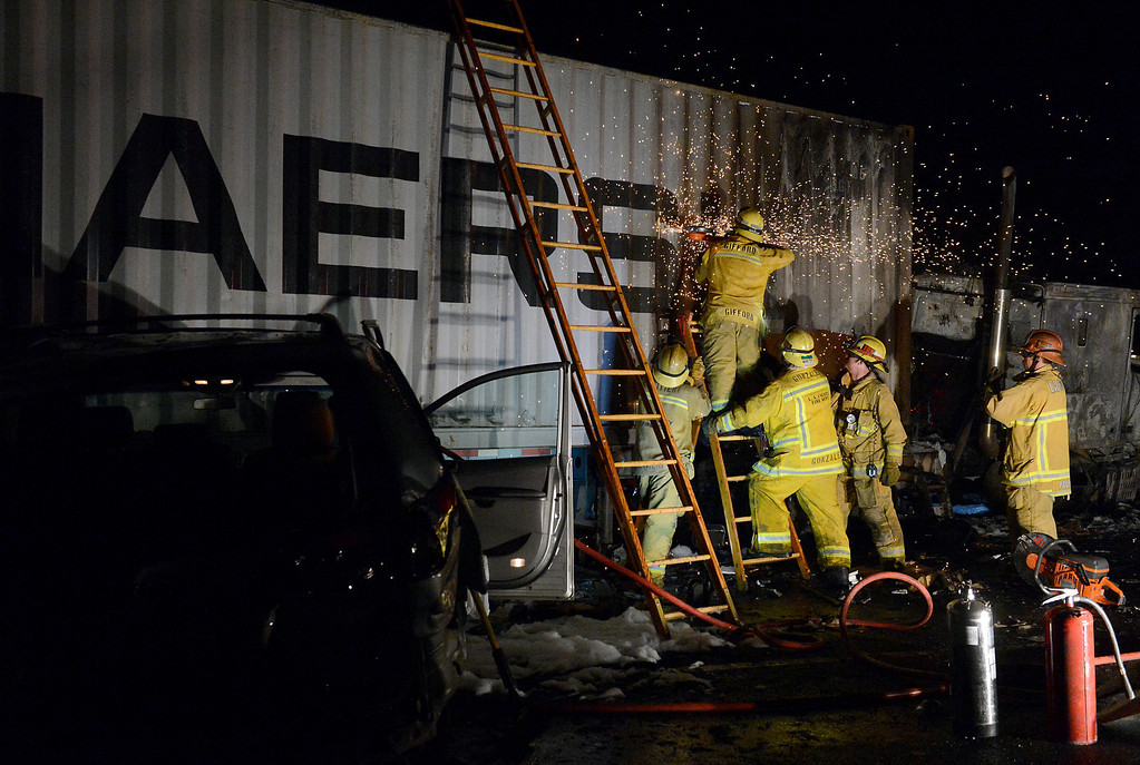 Description of . LA County firefighters work the scene as CHP investigates a fatal traffic collision and fire involving a big rig Monday, August 19, 2013, on the eastbound lanes of the 10 freeway at Towne Ave in Pomona, CA. Jennifer Cappuccio Maher/Inland Valley Daily Bulletin