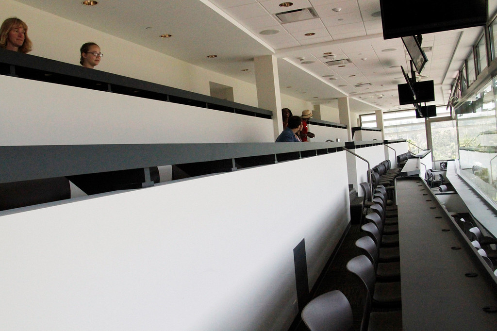 Description of . Visitors sit in the press box during a tour of the newly renovated Pavilion at the Rose Bowl in Pasadena, Saturday, June 8, 2013. The new $84 million Pavilion completed this spring after more then two years of construction, contains premium seating section, press box, sound system and stadium security operations. (Correspondent Photo by James Carbone/SXCITY)