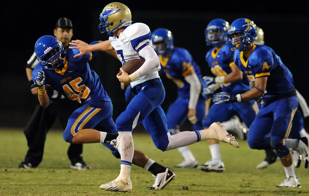 Description of . Santa Margarita quarterback KJ Costello runs for a first down against Bishop Amat in the first half of a prep football game at Bishop Amat High School on Friday, Aug. 30, 2013 in La Puente, Calif.   (Keith Birmingham/Pasadena Star-News)