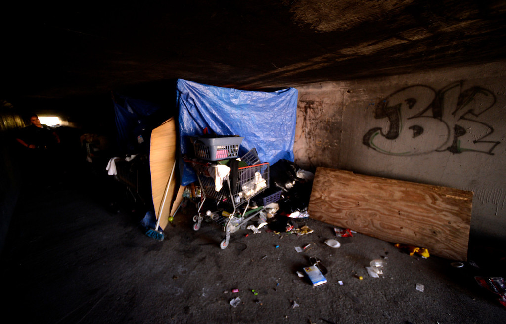 Description of . Evidence of a homeless camp is visible in the wash underneath 40th Street in San Bernardino August 14, 2013.  GABREL LUIS ACOSTA/STAFF PHOTOGRAPHER.