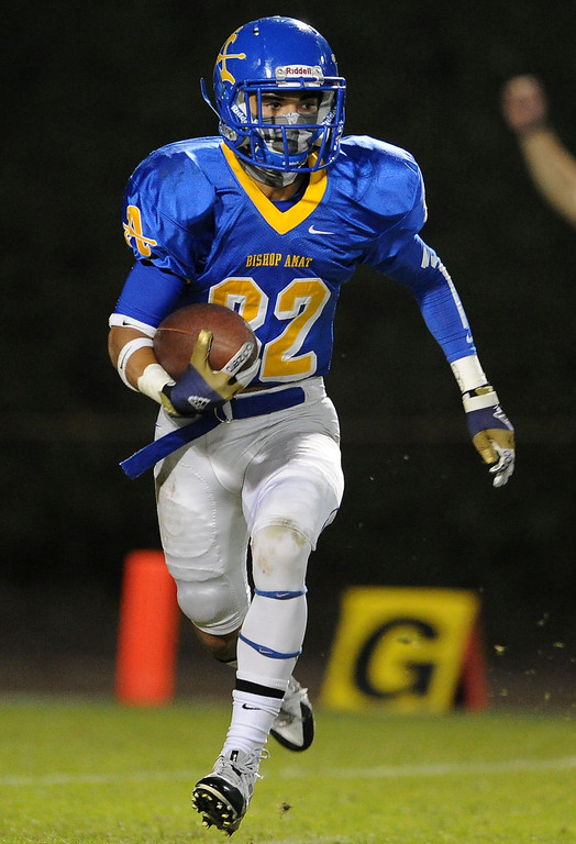 Description of . Bishop Amat's Brandon Arconado runs back a punt for yardage in the first half of a prep football game against Alemany at Bishop Amat High School in La Puente, Calif., on Friday, Oct. 25, 2013.    (Keith Birmingham Pasadena Star-News)