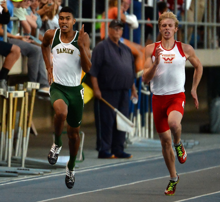 Description of . Damien's Thaddeus Smith, left, competes in the 200 meter dash during the CIF-SS Masters Track and Field meet at Falcon Field on the campus of Cerritos College in Norwalk, Calif., on Friday, May 30, 2014.   (Keith Birmingham/Pasadena Star-News)