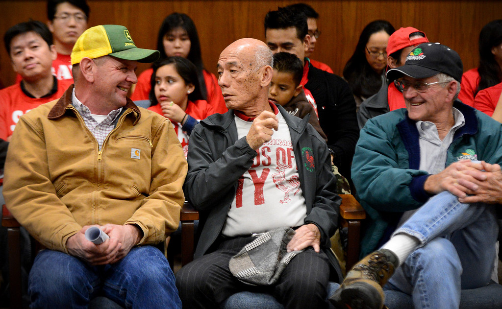 Description of . David Tran, founder and CEO of Huy Fong Foods, sits with his chile growers Jim Roberts, left, and Craig Underwood, of Underwood Ranches, during a public hearing Wednesday night, February 26, 2014 at Irwindale City Council, on whether or not the smell coming from the Huy Fong Foods facility is creating a public nuisance. The city and the Sriracha maker have been entangled in a legal battle since the city filed a temporary restraining order to shut the factory down. The order was denied by a LA County Superior Court judge. (Photo by Sarah Reingewirtz/Pasadena Star-News)