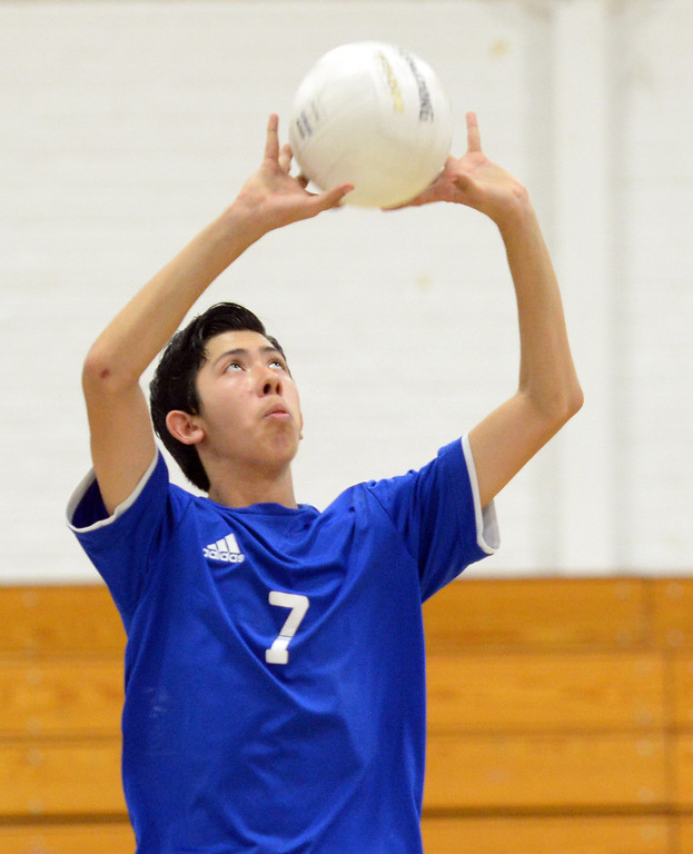 Description of . El Rancho's Anthony Arauz-Diaz (#7) sets the ball as they play Bell Gardens in their non-league game at El Rancho High School in Pico Rivera on Friday March 28, 2014. Bell Gardens defeated El Rancho 3-2 games. (Staff Photo by Keith Durflinger/Whittier Daily News)
