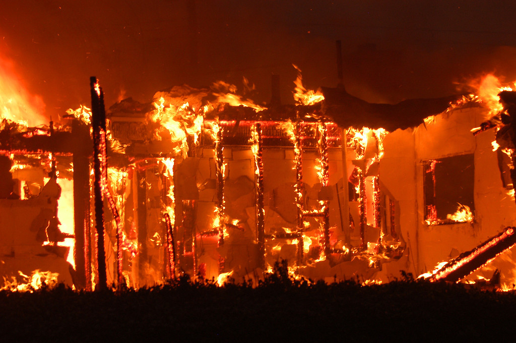 Description of . Ten years ago this month the arson caused Old Fire, fanned by Santa Ana winds burned thousands of acres, destroyed hundreds of homes and caused six deaths. The fire burned homes in San Bernardino, Highland, Cedar Glen, Crestline, Running Springs and Lake Arrowhead and forced the evacuation of thousand of residents.  A home north of Marshal and Elm in San Bernardino is lost to fire on Saturday October 25, 2003.(Staff file photo/The Sun)