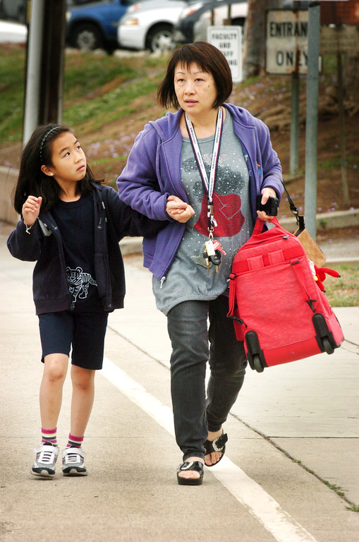Description of . Stephanie Law, a second grade student leaving Brightwood School with her mother Sannie Lau after school cancelled its lockdown. A 19-year-old man was arrested for allegedly making phone calls to the California Highway Patrol threatening gun violence against local schools on Thursday, May 16, 2013. When the suspect called to make the threat, he said he was en route to a college in Monterey Park, she said. The call was made from a cell phone and was received from the East Los Angeles and Monterey Park areas, officials said.About 14 schools were locked down during the incident. At about 9:30 a.m., Santa Monica Community College police arrested a suspect, a 19-year old male in connection with this threat as well as the Santa Monica threat,